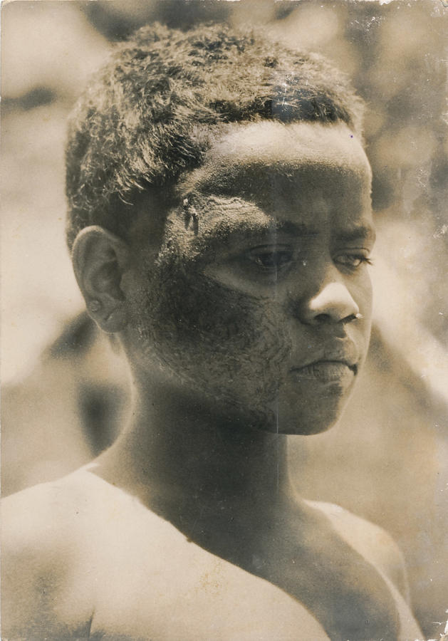Boy showing Tattoo Face Solomon Islands