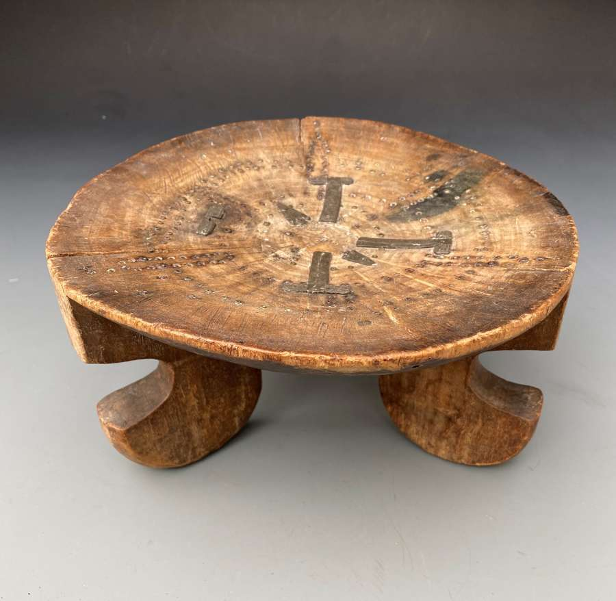 A Kamba Stool with Brass and Pewter designs Kenya