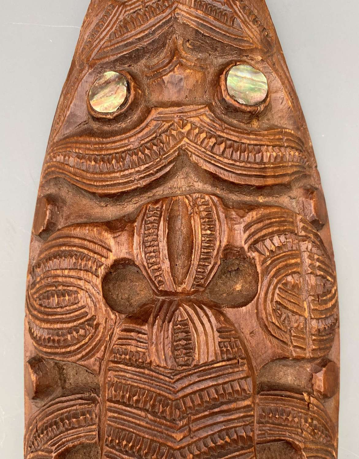 Maori Short Dance Paddle Decorated with Figures. New Zealand