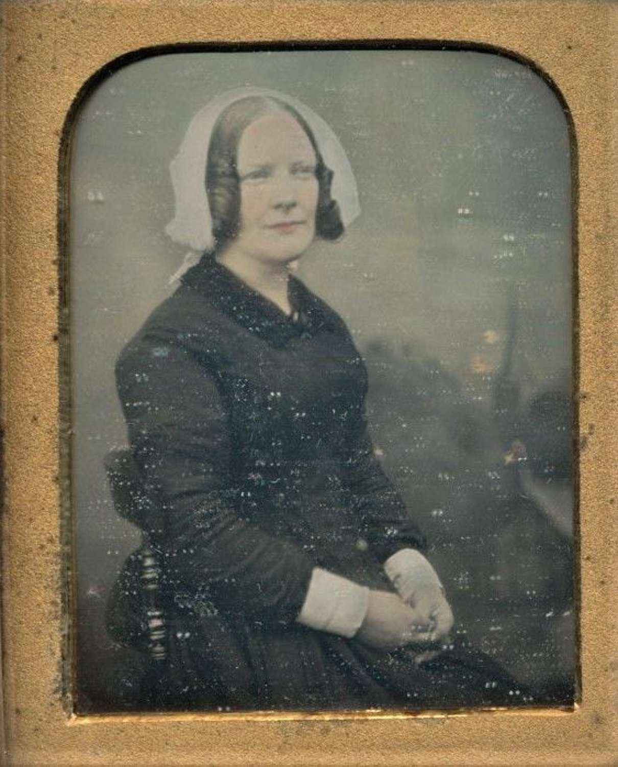 Hand Tinted 1/9 Plate Daguerreotype of Lady wearing Bonnet C1855
