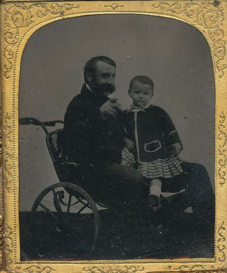 1/6 Plat ambrotype ofa Gentlemen in A Wheelchair with a Child